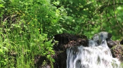 Wonderful place, a waterfall in the mountains. Water flowing through rocks  - stock footage