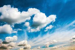 White fluffy clouds on the blue sky Stock Photos