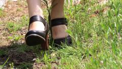 Girl dressed in folk costumes. The legs of a girl wearing shoes with heel Stock Footage
