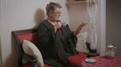 Old woman reading her book Stock Footage
