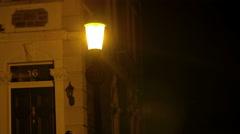 Man in a hoodie walking in the night in a desert street Stock Footage