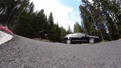 Vehicle traffic on a mountain road in a very tight curve Stock Footage