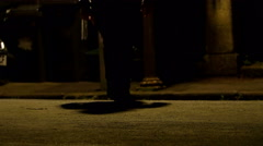 Man walking in a dark street, detail on legs and feet Stock Footage