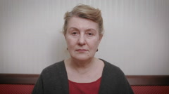 Elderly women and feelings, portrait of serious senior caucasian woman with Stock Footage
