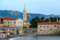 Evening view of the beach and the Old Town of Budva, Montenegro Stock Photos