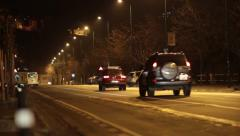 Car traffic at night, on a boulevard in the middle of a big city Stock Footage