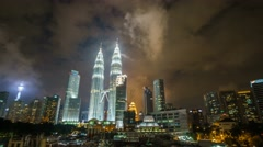 Fast moving night cloud  over Petronas Twin Tower. Motion Pan Left Stock Footage