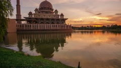 Beautiful sunset with Putra Mosque reflected in the calm lake surface Stock Footage