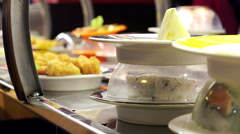 Dishes conveyed on a belt in a fusion restaurant Stock Footage