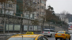 Passage of vehicles along a street in istanbul, cars parked Stock Footage