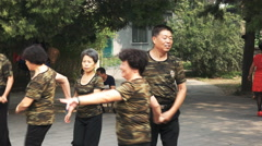 close up of chinese couples dancing outdoors - stock footage