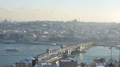 Traffic on the old bridge on the Bosphorus joining two sides of the city Stock Footage