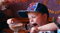 Little Cute Boy in Cap Eat Chocolate Ice Cream Stock Footage