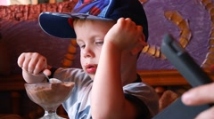 Little Cute Boy in Cap Eat Chocolate Ice Cream Stock Footage