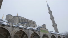 Arches and minarets under the snow in winter in instanbul Stock Footage