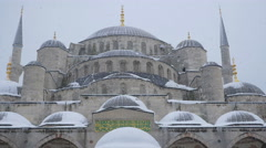 Frontal view of the entrance of the Great Mosque in Istanbul under a snowfall Stock Footage