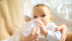 Baby drinking from bottle Stock Footage