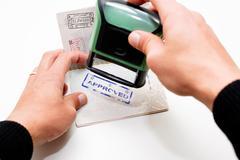 Stamping passport - stock photo