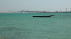 View of Prince Khalifah Bin Salman Causeway from the sea, Bahrain Stock Footage