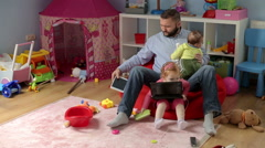 Father spend time with his son and daughter at home  - stock footage