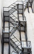 Metal fire stairs on the facade of building Kuvituskuvat