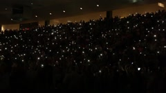 Crowd with phone lights at concert - stock footage