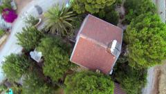Top down of roads, gardens and houses through village Stock Footage
