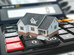 Mortgage calculator. House on buttons. Real estate concept. - stock illustration