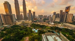 Timelapse of dramatic sunset over KLCC Park. Motion Pan Up Stock Footage