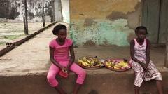 Africa village banana streetsellers children Stock Footage