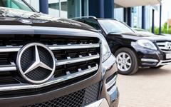Vehicles Mercedes-Benz near the office of official dealer - stock photo