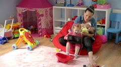 Mother brestfeeding and spend time with kids - stock footage