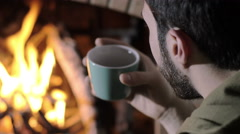 in chrstimas time a man alone at home sat near a burning fire, back view, home - stock footage