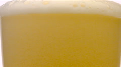 Glass of beer close-up with froth - stock footage