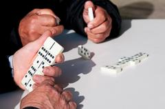 People  playing domino game for leisure Stock Photos
