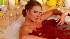 Girl taking bath with rose petals Stock Footage
