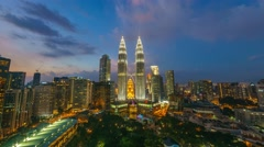 Timelapse of dramatic blue hour scene over KLCC Park. Motion Pan Down Stock Footage