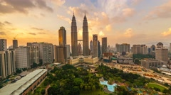 Timelapse of dramatic sunset over KLCC Park. Motion Pan Right Stock Footage