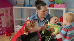 Mum spend time with kids and smile Stock Footage