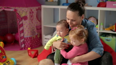 Mother spend time with her babys and pet    - stock footage