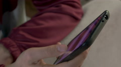 detail of a man scrolling the touchscreen looking for text messages - stock footage