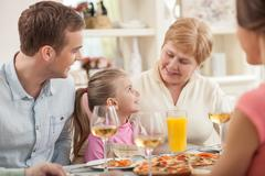 Old lady is celebrating her birthday with family - stock photo