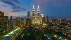 Timelapse of dramatic blue hour scene over KLCC Park. Motion Pan Right Stock Footage
