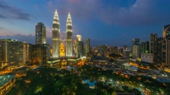 Timelapse of dramatic blue hour scene over KLCC Park. Motion Pan Left Stock Footage