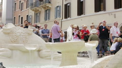 Tourist in Piazza di Spagna taking picture of monumental fountain Stock Footage