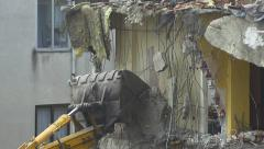 Slow motion a building under demolition. Twisted rebars, broken pillars, rubble Stock Footage