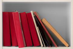 Books in bookcase - stock photo