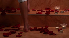 Girl taking bath with rose petals in spa. Dolly crane system Stock Footage
