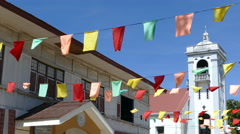 Flags in front of the Santo Nino de Anda Parish Church Stock Footage