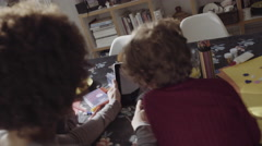 Mother video call with children and father on digital tablet Stock Footage